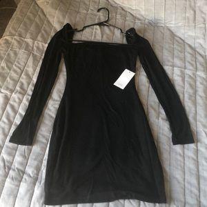 Black bodycon dress by Tobi, brand new with tags.